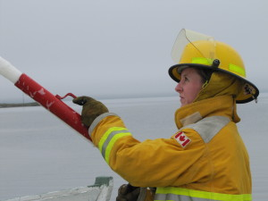 Fire Fighter Samantha Newhook using foam nozzle.